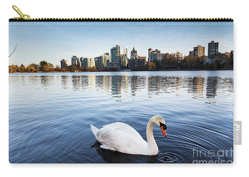Swan Carry-all Pouch featuring the photograph City Swan by Marc Stuelken