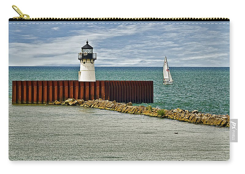 Architecture Carry-all Pouch featuring the photograph Cleveland Harbor Small Lighthouse by Marcia Colelli