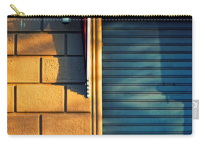 Sunset Carry-all Pouch featuring the photograph Closed Shop Door At Sunset by Silvia Ganora