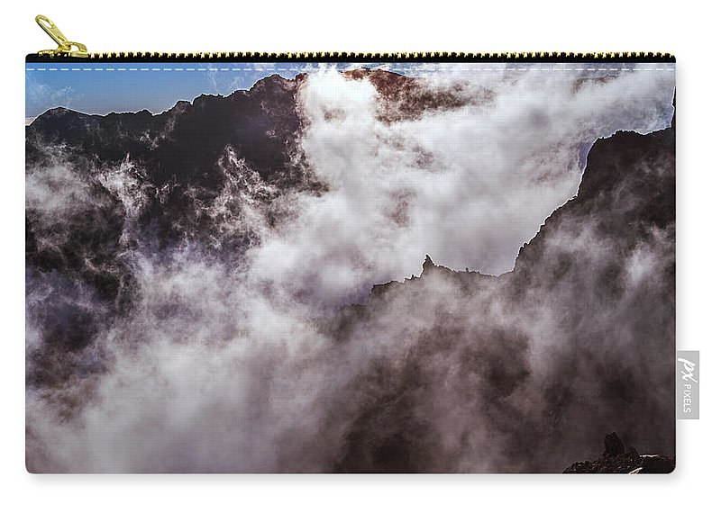 Weather Carry-all Pouch featuring the photograph Clouds In The Caldera De Taburiente by Babak Tafreshi