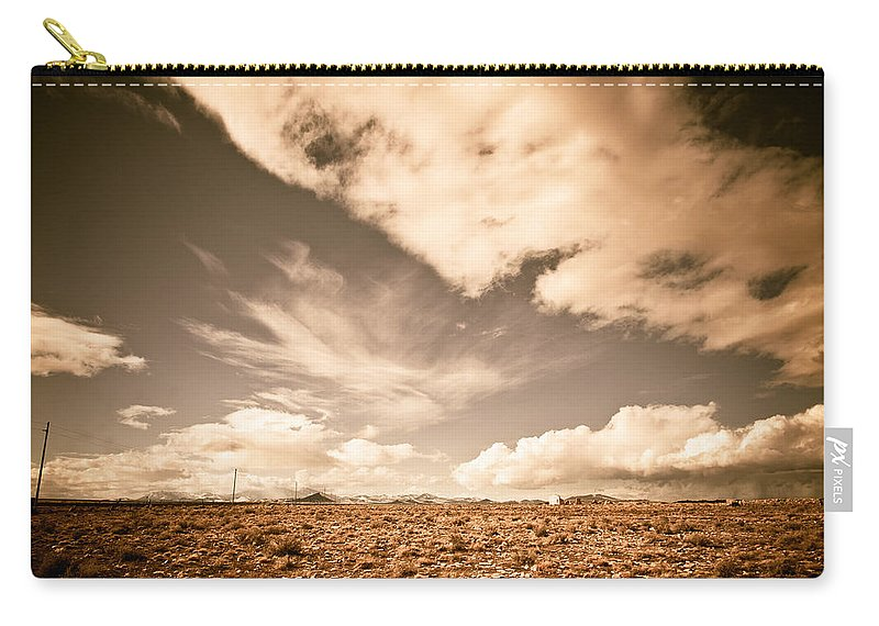 Storm Carry-all Pouch featuring the photograph Cloudy Plain by Scott Sawyer