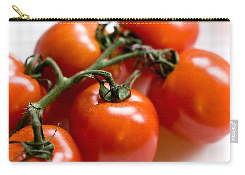 Canon Carry-all Pouch featuring the photograph Cluster Of Tomatoes by Hakon Soreide