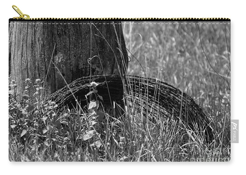 Background Carry-all Pouch featuring the photograph Coiled Devils Rope by Alan Look
