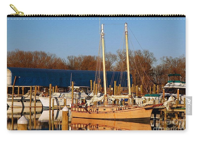 Clay Carry-all Pouch featuring the photograph Colonial Beach Docks by Clayton Bruster