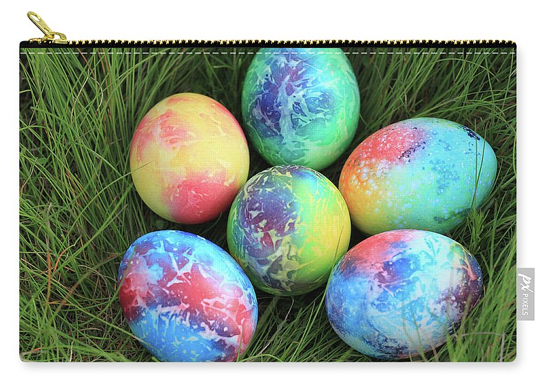 April Carry-all Pouch featuring the photograph Colorful Easter Eggs On Green Grass by Didart Collection