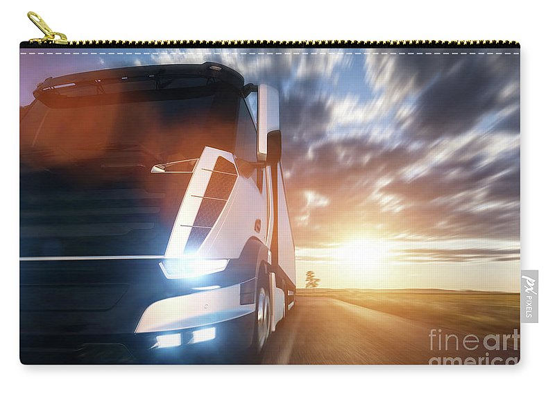 Truck Carry-all Pouch featuring the photograph Commercial Cargo Delivery Truck With Trailer Driving On Highway At Sunset. by Michal Bednarek