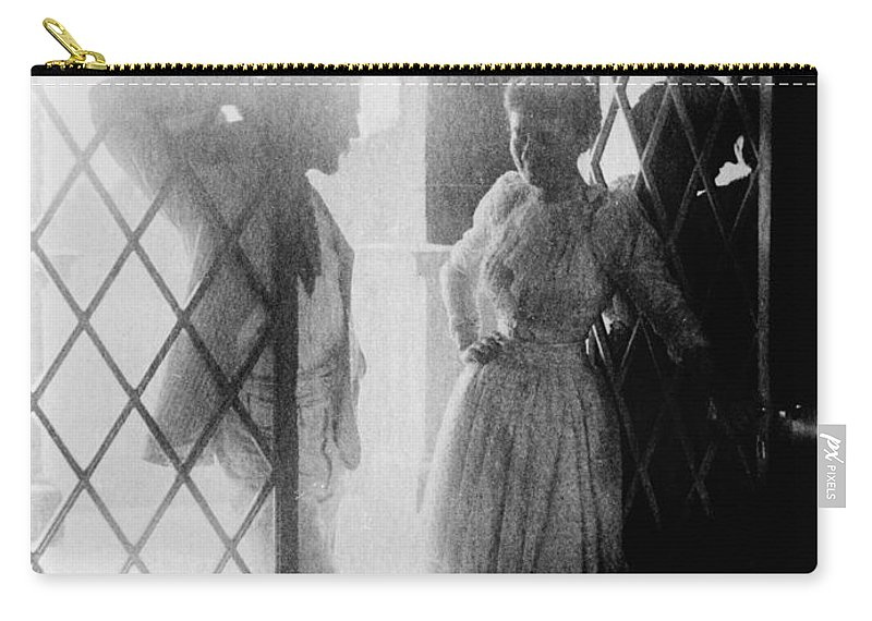 19th Century Carry-all Pouch featuring the photograph Couple In Doorway by Granger