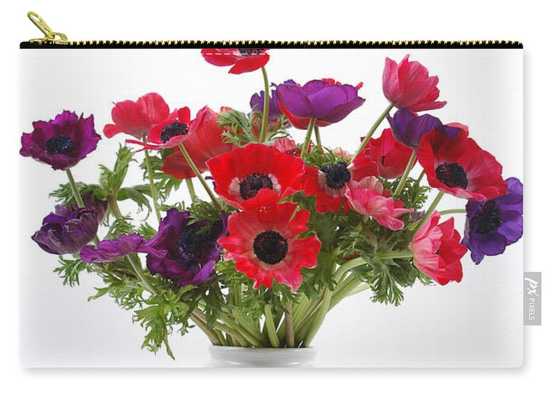 Flower Carry-all Pouch featuring the photograph crown Anemone in a white vase by Ilan Amihai