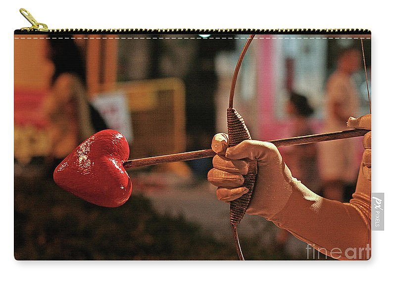 Cupid Carry-all Pouch featuring the photograph Cupid's Arrow by Idan Badishi