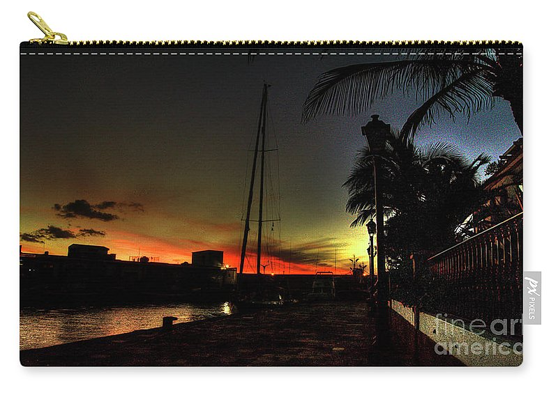 Puerto Carry-all Pouch featuring the photograph Dark Sunlight by Rob Hawkins