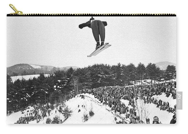1950's Carry-all Pouch featuring the photograph Dartmouth Carnival Ski Jumper by Underwood Archives