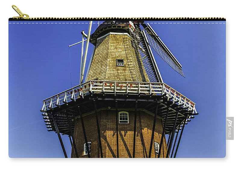 Holland Carry-all Pouch featuring the photograph De Zwaan Windmill In Holland by Nick Zelinsky
