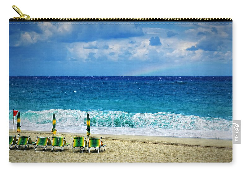 Deck Chairs Carry-all Pouch featuring the photograph Deck Chairs And Distant Rainbow by Silvia Ganora
