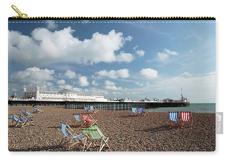Red Carry-all Pouch featuring the photograph Deckchairs On Brighton Beach by Neil Overy