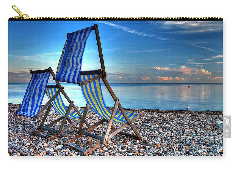 Deckchairs Carry-all Pouch featuring the photograph Deckchairs On The Shingle by Rob Hawkins