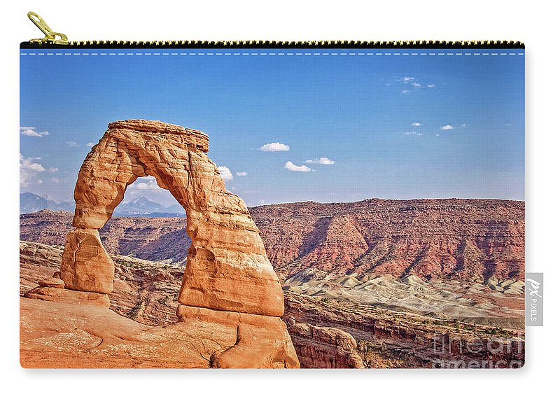 Delicate Arch Carry-all Pouch featuring the photograph Delicate Arch by Delphimages Photo Creations