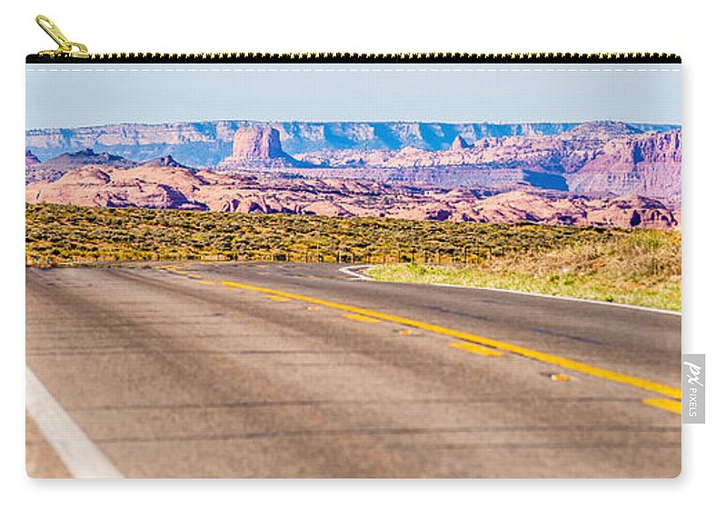 Valley Carry-all Pouch featuring the photograph descending into Monument Valley at Utah Arizona border by Alex Grichenko