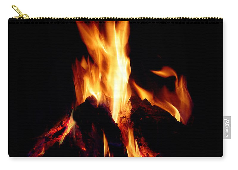 Devil Carry-all Pouch featuring the photograph Devil Fire by Peter Piatt