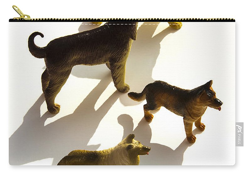 Figurines Carry-all Pouch featuring the photograph Dogs Figurines by Bernard Jaubert