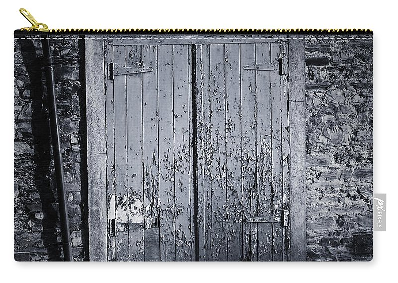 Irish Carry-all Pouch featuring the photograph Door To Nowhere Blarney Ireland by Teresa Mucha