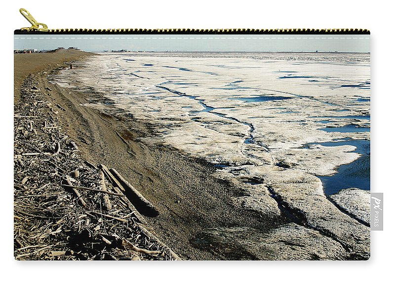 Drift Wood Carry-all Pouch featuring the photograph Driftwood On The Frozen Arctic Coast by Anthony Jones