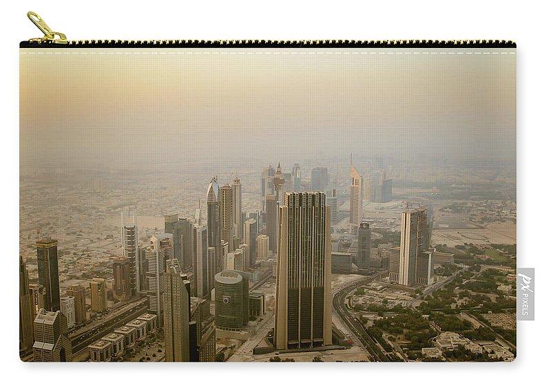 Dubai Carry-all Pouch featuring the photograph Dubai Skyline At Evening by Aashish Vaidya