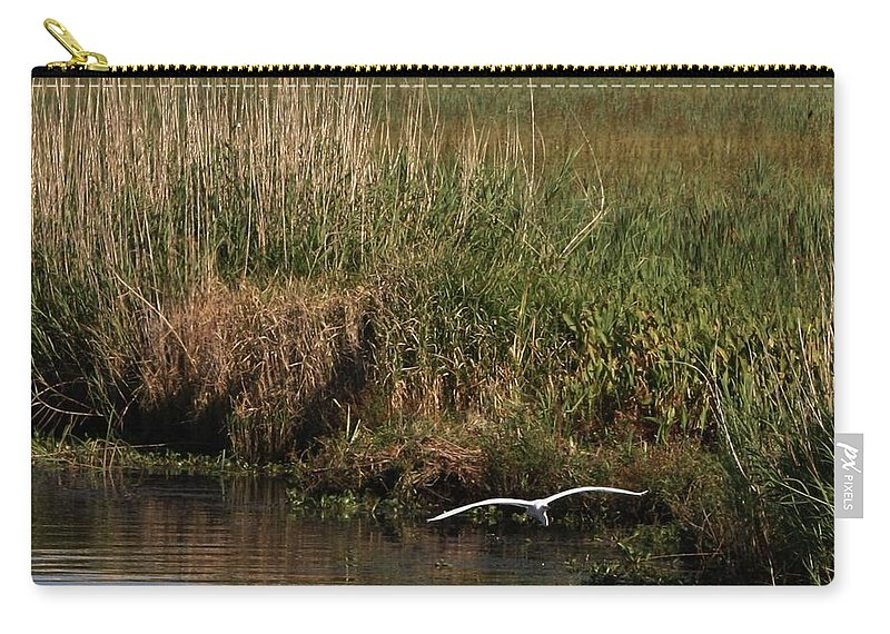 Egret Flying On The Bayou Carry-all Pouch featuring the photograph Egret On The Bayou by Kathy Kirkland