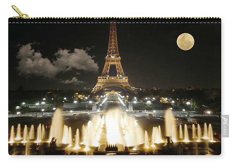 Paris Carry-all Pouch featuring the photograph Eiffel Tower At Night by Jon Delorme