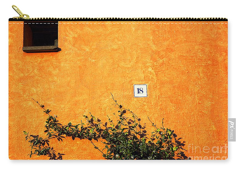 Numbers Carry-all Pouch featuring the photograph Eighteen On Orange Wall by Silvia Ganora