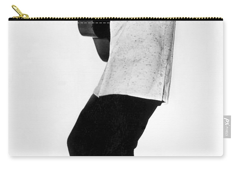 1 Person Carry-all Pouch featuring the photograph Elvis Presley In 1956 by Underwood Archives