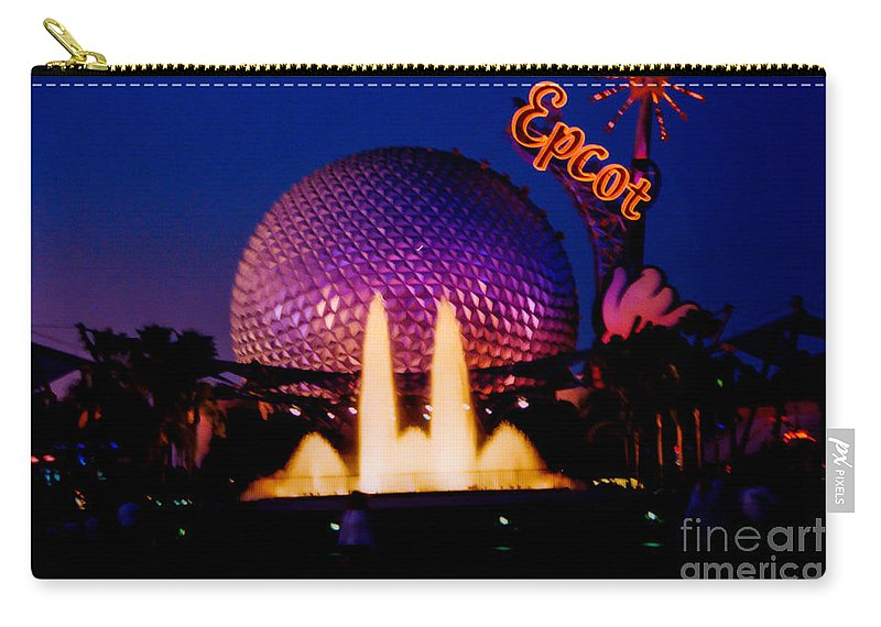 Disney World Carry-all Pouch featuring the photograph Epcot At Night by Tommy Anderson