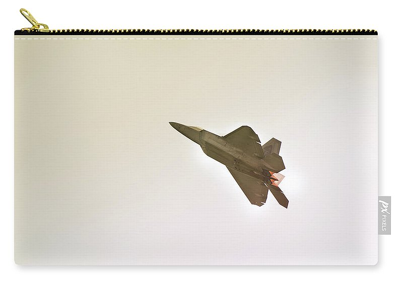 Airplane Carry-all Pouch featuring the photograph F-22 Raptor by Sebastian Musial