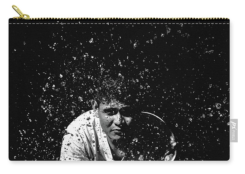 Splash Carry-all Pouch featuring the photograph Face Splash by Sheikh Qayyum
