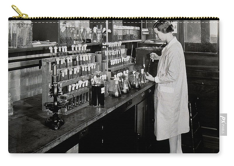 Historic Carry-all Pouch featuring the photograph Female Scientist Conducting Experiment by Wellcome Images