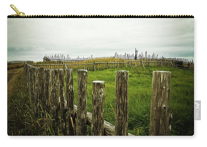 Fence Carry-all Pouch featuring the photograph Fences In A Stormy Light by Tatiana Travelways