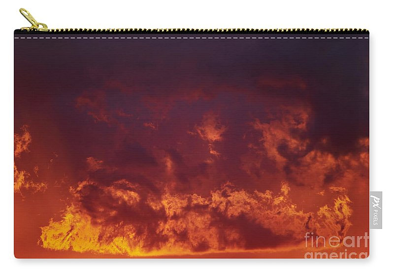 Sunset Carry-all Pouch featuring the photograph Fiery Clouds by Michal Boubin