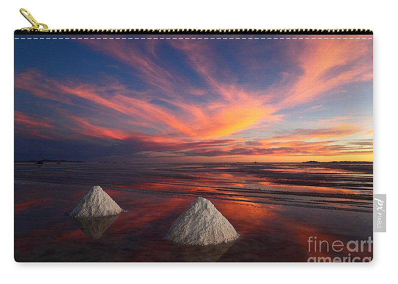 Salar De Uyuni Carry-all Pouch featuring the photograph Fiery Sunset Over The Salar De Uyuni by James Brunker