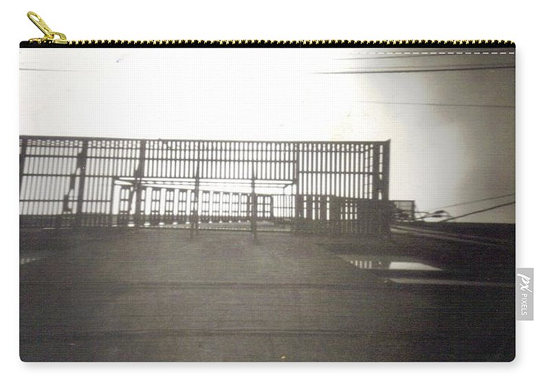 Black And White Photograph Carry-all Pouch featuring the photograph Fire Escape by Thomas Valentine