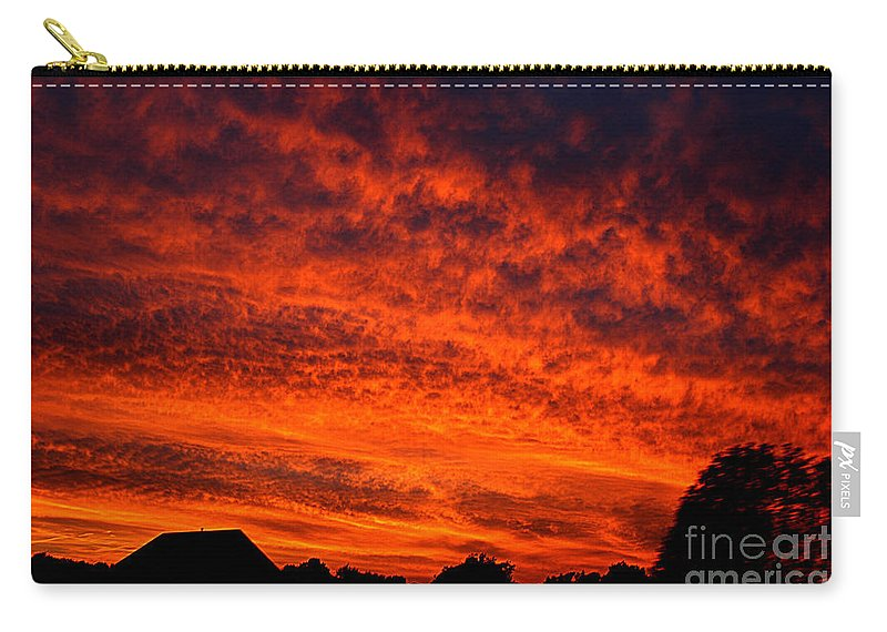 Clay Carry-all Pouch featuring the photograph Fire In The Sky by Clayton Bruster