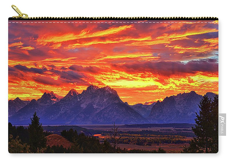 Tetons Carry-all Pouch featuring the photograph Fire In The Teton Sky by Greg Norrell