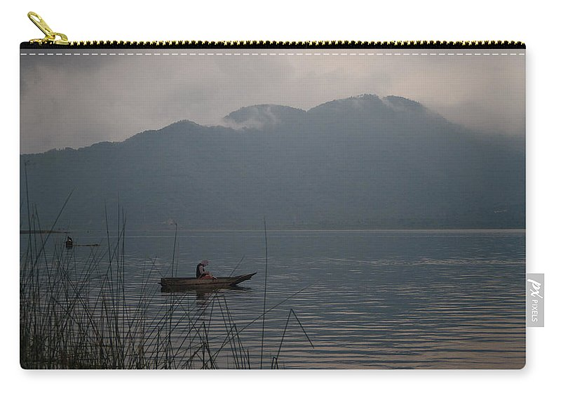 Lone Carry-all Pouch featuring the photograph Fisherman Baiting Line Lake Atitlan Guatemala by Douglas Barnett