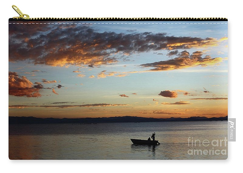 Peru Carry-all Pouch featuring the photograph Fishing At Sunset On Lake Titicaca by James Brunker
