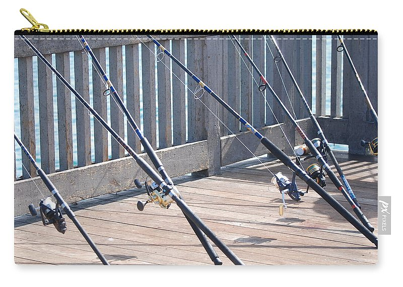 Pier Carry-all Pouch featuring the photograph Fishing Rods by Rob Hans