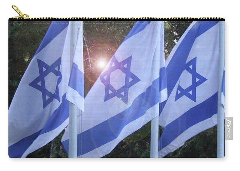 Flags Carry-all Pouch featuring the photograph Flags Of Israel Blowing In The Wind by Eliyahu Shear