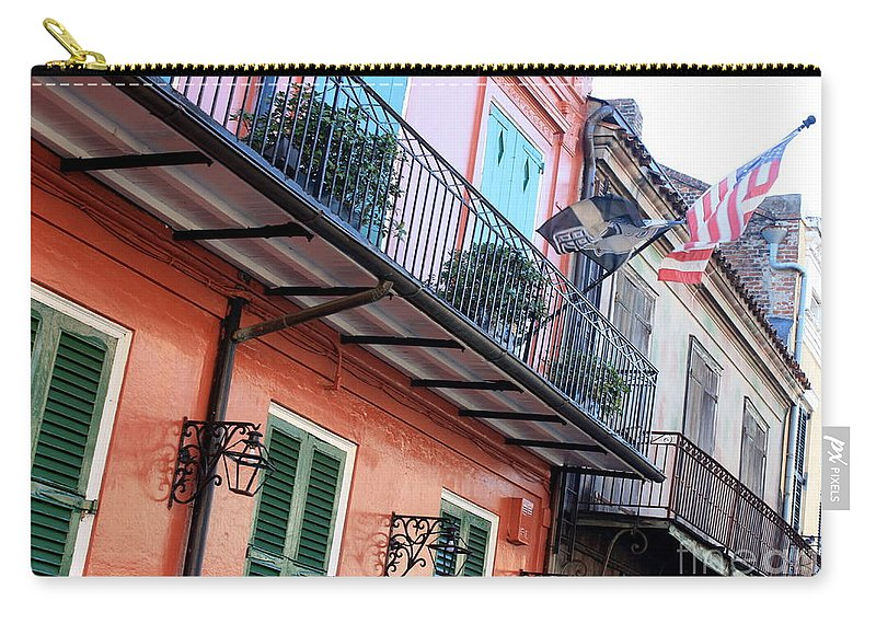 New Orleans Carry-all Pouch featuring the photograph Flags On The Balcony by Carol Groenen