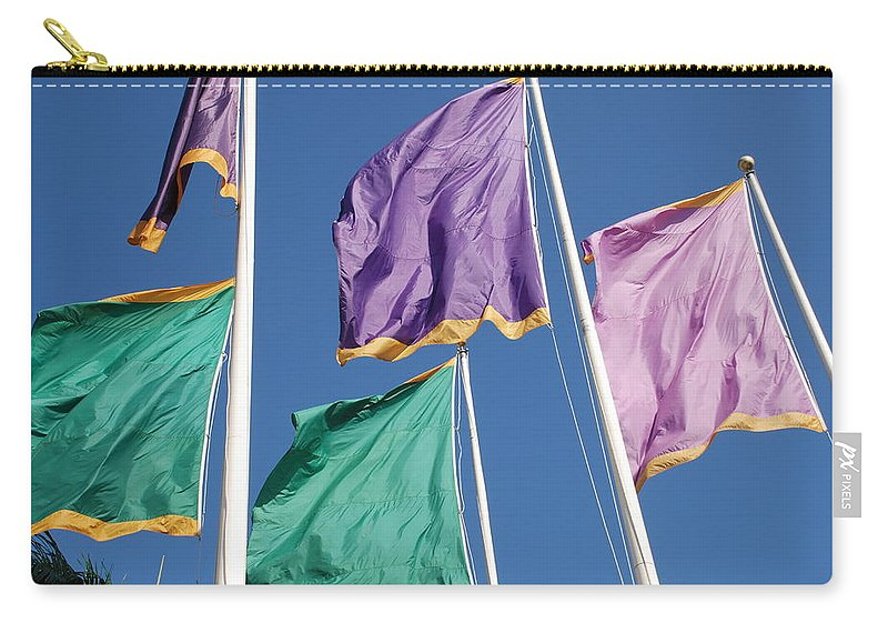 Flags Carry-all Pouch featuring the photograph Flags by Rob Hans