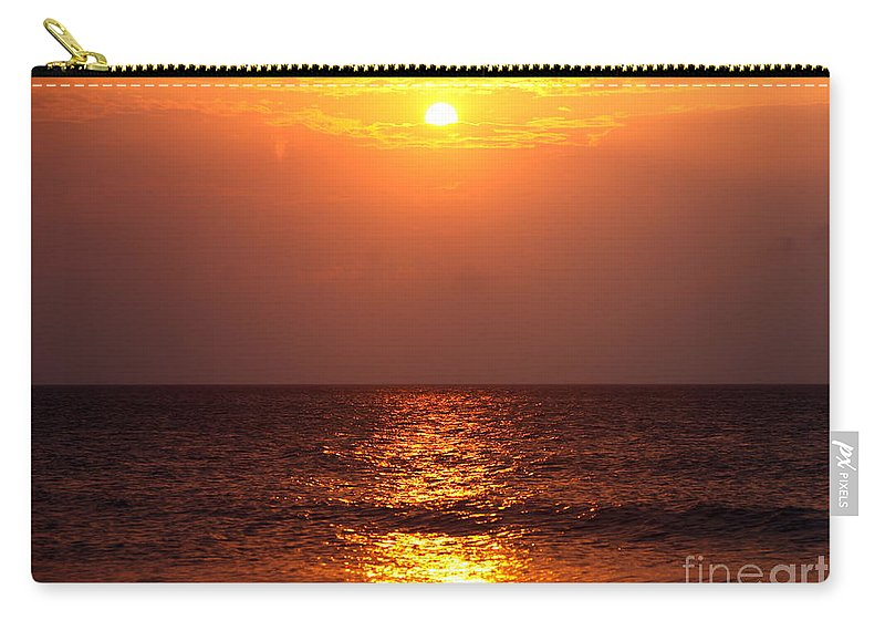 Sunrise Carry-all Pouch featuring the photograph Flaming Sunrise by Nadine Rippelmeyer