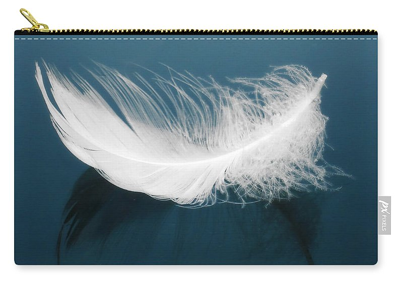 Aqua Carry-all Pouch featuring the photograph Floating Feather by Svetlana Sewell