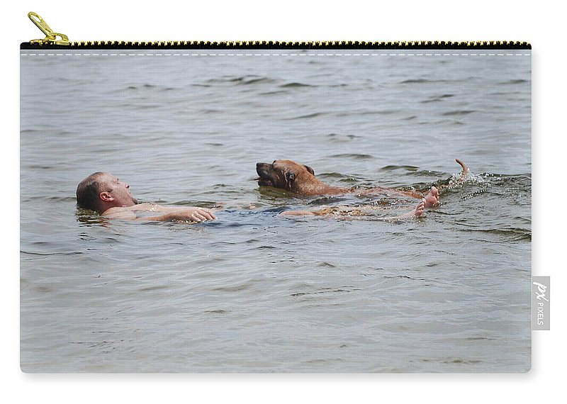 Man Carry-all Pouch featuring the photograph Floating In The Sea by Rob Hans