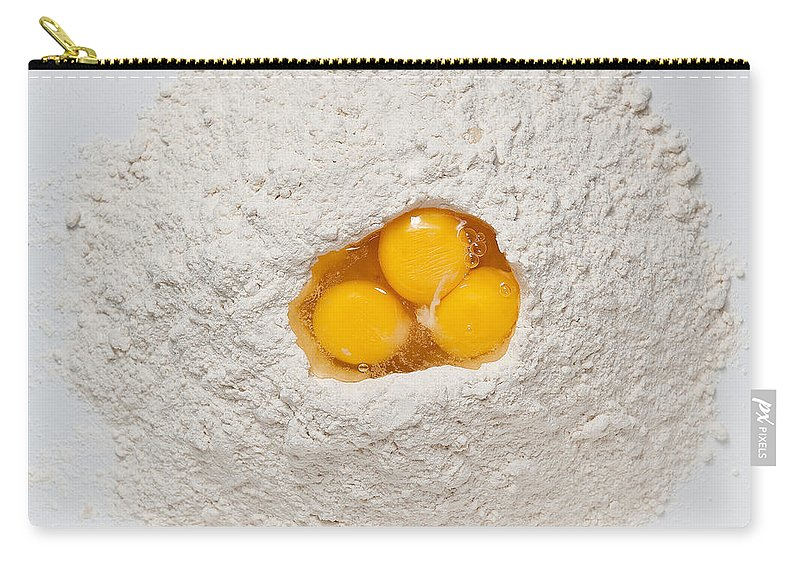 Flour Carry-all Pouch featuring the photograph Flour And Eggs by Steve Gadomski
